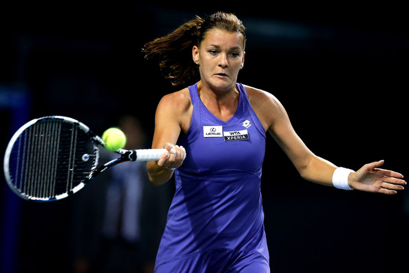 Agnieszka Radwanska of Poland plays a forehand in her first round match against Jelena Jankovic of Serbia during day three of the Toray Pan Pacific Open at Ariake Colosseum on September 25, 2012 in Tokyo, Japan.