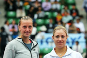 Winner Petra Kvitova of Czech Republic (L) celebrates with her plate after her women's singles final match against Angelique Kerber of Germany during