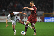 Jasmin Kurtic (R) of Torino FC clashes with Djamel Mesbah of AS Livorno Calcio during the Serie A match between Torino FC and AS Livorno Calcio at Stadio Olimpico di Torino on March 22, 2014 in Turin, Italy.
