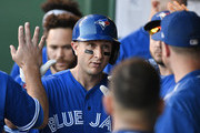 KANSAS CITY, MO -JUNE 23: Troy Tulowitzki #2 of the Toronto Blue Jays is congratulated by teammates after scoring on wild pitch by Jake Junis #65 of the Kansas City Royals in the fourth inning at Kauffman Stadium on June 23, 2017 in Kansas City, Missouri.