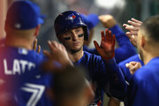 Troy Tulowitzki #2 of the Toronto Blue Jays is congratulated in the dugout after scoring during the sixth inning of a game against the Los Angeles Angels of Anaheim at Angel Stadium of Anaheim on April 21, 2017 in Anaheim, California.