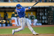 Troy Tulowitzki #2 of the Toronto Blue Jays hits an rbi singles scoring Jose Bautista #19 against the Oakland Athletics in the top of the fourth inning at Oakland Alameda Coliseum on June 6, 2017 in Oakland, California.