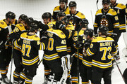 Goalie Tuukka Rask #40 of the Boston Bruins is congratulated by the team after the victory over the Toronto Maple Leafs in Game Seven of the Eastern Conference First Round during the 2019 NHL Stanley Cup Playoffs at TD Garden on April 23, 2019 in Boston, Massachusetts.