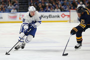 Mitchell Marner #16 of the Toronto Maple Leafs skates up ice with the puck as Kyle Okposo #21 of the Buffalo Sabres defends during the third period at KeyBank Center on March 5, 2018 in Buffalo, New York.