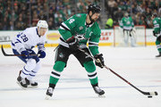 Jamie Benn #14 of the Dallas Stars skates the puck against the Toronto Maple Leafs at American Airlines Center on January 25, 2018 in Dallas, Texas.