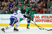Jamie Benn #14 of the Dallas Stars skates the puck against Ron Hainsey #2 of the Toronto Maple Leafs  at American Airlines Center on January 25, 2018 in Dallas, Texas.