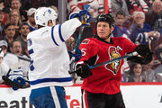 Chris Neil #25 of the Ottawa Senators jousts with Matt Martin #15 of the Toronto Maple Leafs during a face-off at Canadian Tire Centre on October 12, 2016 in Ottawa, Ontario, Canada.