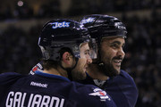 Dustin Byfuglien #33 of the Winnipeg Jets congratulates teammate TJ Galiardi #21 for his goal in second period action in an NHL game against the Toronto Maple Leafs at the MTS Centre on January 3, 2015 in Winnipeg, Manitoba, Canada.