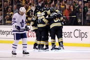 Tomas Plekanec #19 of the Toronto Maple Leafs reacts as members of the Boston Bruins congratulate David Pastrnak #88 after scoring a goal during the second period of Game One of the Eastern Conference First Round during the 2018 NHL Stanley Cup Playoffs at TD Garden on April 12, 2018 in Boston, Massachusetts.