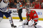 Cam Ward #30 of the Chicago Blackhawks stops a redirect by Connor Brown #28 of the Toronto Maple Leafs during the regular seaspn opening home game at the United Center on October 7, 2018 in Chicago, Illinois.