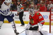 Cam Ward #30 of the Chicago Blackhawks stops a redirect by Connor Brown #28 of the Toronto Maple Leafs during the regular seasopn opening home game at the United Center on October 7, 2018 in Chicago, Illinois.