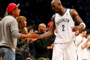 Kevin Garnett #2 of the Brooklyn Nets is congratulated by Jay-Z after Garnett was pulled from the game in the fourth quarter against the Toronto Raptors in Game Six of the Eastern Conference Quarterfinals during the 2014 NBA Playoffs at the Barclays Center on May 2, 2014 in the Brooklyn borough of New York City. NOTE TO USER: The Brooklyn Nets defeated the Toronto Raptors 97-83. User expressly acknowledges and agrees that, by downloading and/or using this photograph, user is consenting to the terms and conditions of the Getty Images License Agreement.
