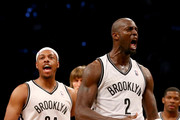 Kevin Garnett #2 of the Brooklyn Nets celebrates with teammate Paul Pierce #34 in the second quarter against the Toronto Raptors in Game Three of the Eastern Conference Quarterfinals during the 2014 NBA Playoffs at the Barclays Center on April 25, 2014 in the Brooklyn borough of New York City. NOTE TO USER: User expressly acknowledges and agrees that, by downloading and/or using this photograph, user is consenting to the terms and conditions of the Getty Images License Agreement.