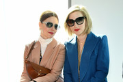 Christene Barberich and Gabrielle Korn attend the Tory Burch Fall Winter 2019 Fashion Show at Pier 17 on February 10, 2019 in New York City.