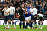 Harry Arter of Cardiff City confronts referee Mike Dean after Joe Ralls of Cardiff City recieves a red card during the Premier League match between Tottenham Hotspur and Cardiff City at Tottenham Hotspur Stadium on October 6, 2018 in London, United Kingdom.