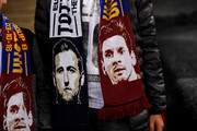 The faces of Harry Kane and Lionel Messi pictured on the scarf of a supporter prior to the Group B match of the UEFA Champions League between Tottenham Hotspur and FC Barcelona at Wembley Stadium on October 3, 2018 in London, United Kingdom.