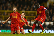 Jordan Henderson of Liverpool celebrates scoring their second goal with Mamadou Sakho of Liverpool (R) during the Barclays Premier League match between Tottenham Hotspur and Liverpool at White Hart Lane on December 15, 2013 in London, England.