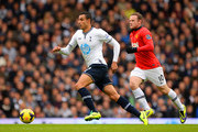 Wayne Rooney of Manchester United tracks Nacer Chadli of Tottenham Hotspur during the Barclays Premier League Match between Tottenham Hotspur and Manchester United at White Hart Lane on December 1, 2013 in London, England.