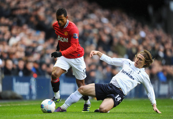 Luka Modric of Tottenham Hotspur attempts to tackle Nani of Manchester United during the Barclays Premier League match between Tottenham Hotspur and Manchester United at White Hart Lane on March 4, 2012 in London, England.