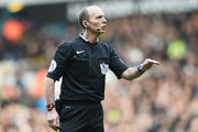 Referee Mike Dean gestures during the Barclays Premier League match between Tottenham Hotspur and Sunderland at White Hart Lane on January 16, 2016 in London, England.