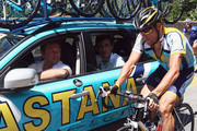 Lance Armstrong of the USA and Astana talks to team Manager Johan Bruyneel on stage 20 of the 2009 Tour de France from Montelimar to Mont Ventoux on July 25, 2009 in Montelimar, France.