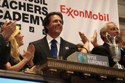 2013 British Open golf champion Phil Mickelson (R), and his wife Amy stand next to his winning Claret Jug at the closing bell of the New York Stock Exchange on July 26, 2013 in New York City. The American golfer was there to promote his ExxonMobile Teachers Academy charity.