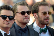"""(L-R) Orlando Bloom, Leonardo DiCaprio and Jean-Eric Vergne attend the screening of """"The Traitor"""" during the 72nd annual Cannes Film Festival on May 23, 2019 in Cannes, France."""