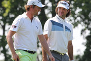 Webb Simpson and Bubba Watson walk toward the 9th green during Round One of the 2012 Travelers Championship at TPC River Highlands on June 21, 2012 in Cromwell, Connecticut.