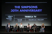 """(L-R) Showrunner and Executive Producer Al Jean, Executive Producer James L. Brooks, creator and Executive Producer Matt Groening, actor and voice of multiple characters Harry Shearer, Executive Producer Matt Selman, and actor, panel moderator, and voice of Lisa Simpson Yeardley Smith, speak on stage at """"Tribeca TV: The Simpsons 30th Anniversary"""" during the 2019 Tribeca Film Festival at BMCC Tribeca PAC on April 28, 2019 in New York City."""
