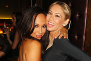 Cheryl Burke and Kym Johnson attend Executive Producer Tricky Stewart and Executive Producer Mark Stewart's annual Red Zone pre Grammy party at Greystone Manor Supperclub on February 10, 2012 in West Hollywood, California.