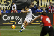 Tobin Heath #17 of the United States kicks the ball against Trinidad & Tobago during an international friendly match at the Alamodome on December 10, 2015 in San Antonio, Texas.