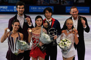 (L-R)  Meagan Duhamel and Eric Radford (silver medal) of Canada, Qing Pang and Jian Tong (gold medal) of China and Caydee Denney and John Coughlin (bronze medal) of the USA pose after the Paris Free Skating event during day two of Trophee Eric Bompard ISU Grand Prix of Figure Skating 2013/2014 at the Palais Omnisports de Bercy on November 16, 2013 in Paris, France.