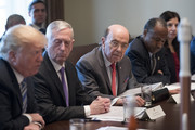 (AFP OUT) US Secretary of Commerce Wilbur Ross (C), US Secretary of Housing and Urban Development (HUD) Ben Carson (R) and US Secretary of Defense Jim Mattis (2-L) listen to US President Donald J. Trump (L) deliver remarks during a meeting with members of his Cabinet, in the Cabinet Room of the White House March 8, 2018 in Washington, DC,