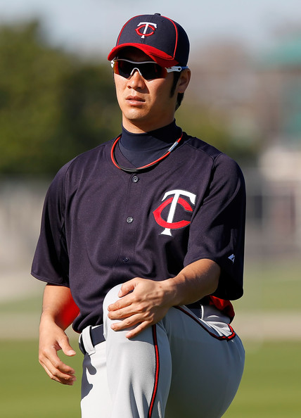 Tsuyoshi Nishioka Infielder Tsuyoshi Nishioka #1 of the Minnesota Twins warms up during a spring training workout session at Hammond Stadium on February 23, 2011 in Fort Myers, Florida.