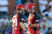 Daniel Harris and Dan Christian of the Redbacks talk between overs during the Twenty20 Big Bash match between the South Australian Redbacks and the Queensland Bulls at Adelaide Oval on January 20, 2011 in Adelaide, Australia.