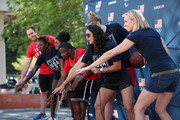 Team USA athletes Alex Bowen, Ashleigh Johnson, Kendall Ellis, Carlin Isles, Katie Lou Samuelson, Maggie Steffens and Dana Vollmer celebrate the two year countdown to the 2020 Olympic Games in Tokyo at a Youth Sports Clinic at the Japanese American Community Center on July 24, 2018 in Los Angeles, California.