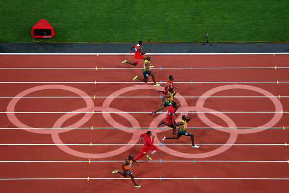 Tyson Gay Usain Bolt of Jamaica on his way to winning gold in the Men?