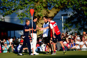 Justin Rose of England, Luke Donald of England, caddie John McLaren and caddie Mark Fulcher shake hands on the 18th green during the final round of the 113th U.S. Open at Merion Golf Club on June 16, 2013 in Ardmore, Pennsylvania.