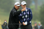 Justin Rose of England chats with his caddie Mark Fulcher during a practice round prior to the start of the 112th U.S. Open at The Olympic Club on June 13, 2012 in San Francisco, California.