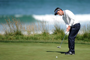 Edoardo Molinari of Italy hits a putt on the tenth green during the first round of the 110th U.S. Open at Pebble Beach Golf Links on June 17, 2010 in Pebble Beach, California.