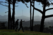 Justin Rose of England walks with his caddie Mark Fulcher during the second round of the 112th U.S. Open at The Olympic Club on June 15, 2012 in San Francisco, California.