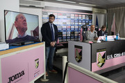 President Maurizio Zamparini (L) joins via conference call as Team Manager Alessio Cracolici, Davide Ballardini and Sport Manager Manuel Gerolin look on during Ballardini's presentation as new head coach of Palermo at Stadio Renzo Barbera on November 10, 2015 in Palermo, Italy.