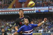 Djamel Mesbah of UC Sampdoria competes for the ball with Mario Gomez (back) of ACF Fiorentina during the Serie A match between UC Sampdoria and ACF Fiorentina at Stadio Luigi Ferraris on November 2, 2014 in Genoa, Italy.