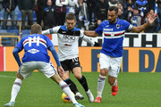 Alejandro Gomez of Atalanta BC opposed to Fabio Quagliarella and Jakub Jankto of UC Sampdoria during the Serie A match between UC Sampdoria and Atalanta BC at Stadio Luigi Ferraris on November 10, 2019 in Genoa, Italy.