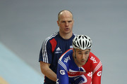Ross Edgar of Great Britain practices his sprint starts with the help of British Cycling Coach Jan van Eijden during the UCI Track Cycling World Cup - LOCOG Test Event for London 2012 Media Day at the London Olympic Velodrome on February 14, 2012 in London, England.