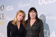 Rebecca De Mornay and Anjelica Huston attend the UCLA IoES honors Barbra Streisand and Gisele Bundchen at the 2019 Hollywood for Science Gala on February 21, 2019 in Beverly Hills, California.