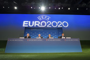 UEFA General Secretary Gianni Infantino, English Football Association (FA) Chairman Greg Dyke, UEFA President Michel Platini and UEFA Chief of Press Pedro Pinto speak during a press conference following the UEFA EURO 2020 Host Cities & Final announcement ceremony held at Espace Hippomene on September 19, 2014 in Geneva, Switzerland.