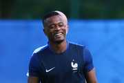 Patrice Evra smiles during a France training session on the eve of the UEFA EURO 2016 Final against Portugal at Clairefontaine on July 9, 2016 in Paris, France.