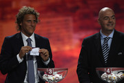 Diego Forlan (l) of Atletico Madrid and Uruguay alongside UEFA General Secretary Gianni Infantino (r) during the UEFA Europa League Group Stage Draw at the Grimaldi Forum on August 27, 2010 in Monaco, Monaco.