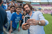 Andrea Pirlo takes a selfie with fans before the UEFA Match for Solidarity at Stade de Geneva on April 21, 2018 in Geneva, Switzerland.